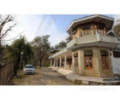 Get The Kashmir House-HPTDC in,Dharamshala with Class Accommodation.